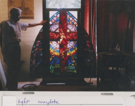 Philip Handel with stained-glass window