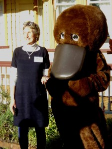 Crawford House Curator Jane Gardiner with platypus mascot at the platypus skin rug display launch