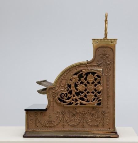 Detail of side of gold cash register