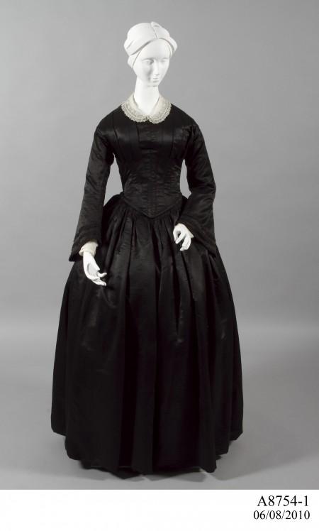 Black silk mourning dress on manikin