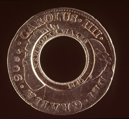 Photograph of silver coin, 'Holey dollar'