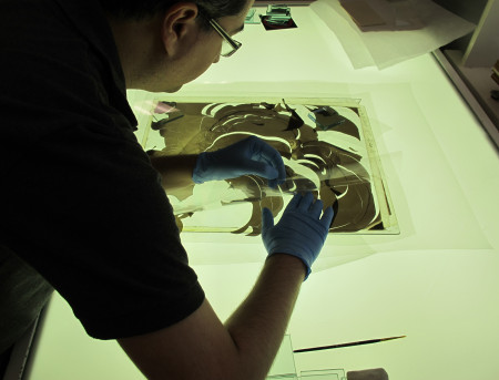 Photograph of Amir laying the curly emulsion into place