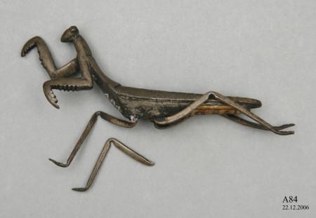 Photograph of bronze praying mantis