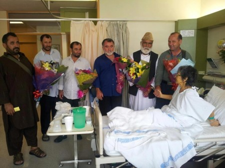 Photograph of Afghan refugees visiting a volunteer in hospital
