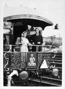 The Queen and Prince Philip waving from the observation platform of the Museum's Governor-General's carriage