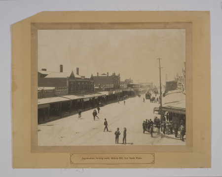 """Photographic print, """"Argent Street Broken Hill"""", Silver Gelatine print on paper mounted, Broken Hill, NSW, 1910, Photograph of main street with teams and men standing around. Inscription: """"Argent Street, looking north, Broken Hill New South Wales"""