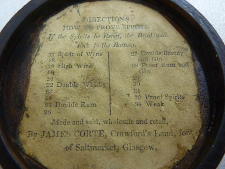 Detail of label inside the lid of Philosophical Bubbles for gauging density of liquids