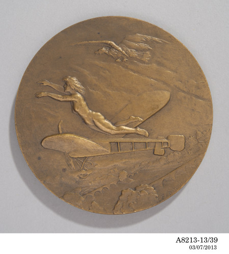 A bronze aviation award medal from France, featuring a Bleriot XI aircraft, the allegorical Angel of Flight, and an eagle