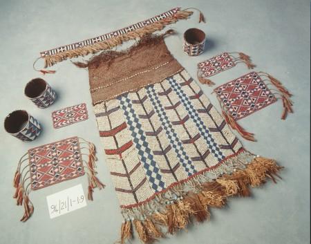 Photograph of Ceremonial regalia and shell money (nine pieces)