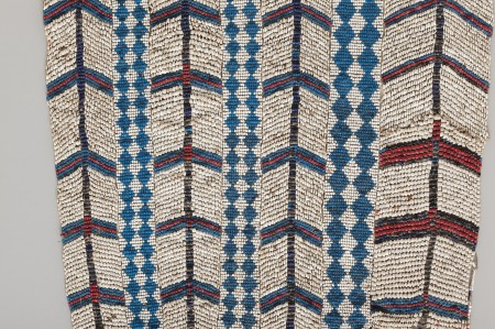 Detail of apron showing beaded shell money