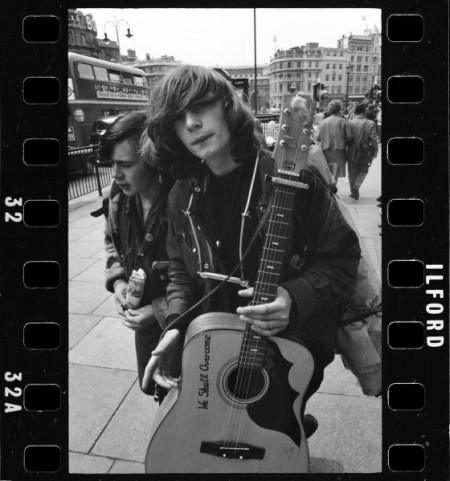 Musician on the street, London, late 1950s