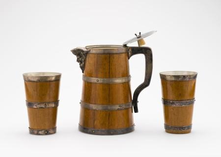 Beakers (2) and lidded jug, electroplated silver / oak