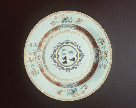 Photograph of armorial dish, porcelain, underglaze blue with 'rouge de fer' (iron red) enamels and gilding, bearing the arms of Booth impaling Irvine of Drum, Jingdezhen, China, Qianlong Period, Qing Dynasty, c1723.