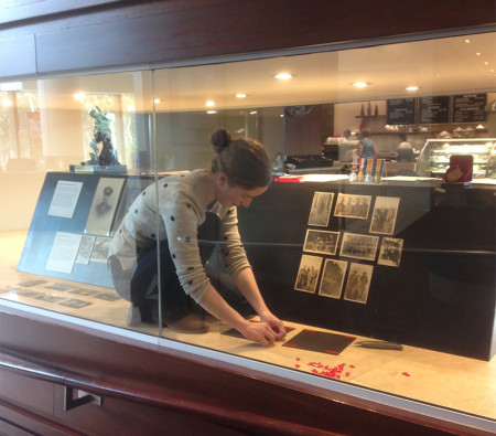 MAAS curatorial volunteer Kate Clancy installing Centenary of Anzac Exhibition at Castle Hill RSL