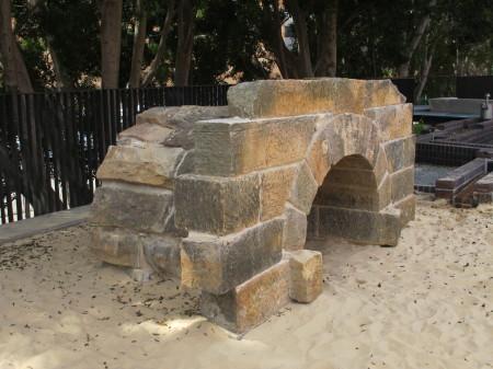 The sandstone culvert re-erected on the walkway
