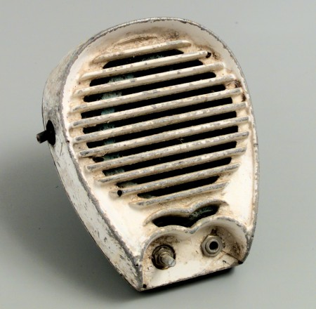 SA white painted speaker showing clear signs of rust and ageing. The paint is wearing away around the speaker's edge revealing the metal underneath.