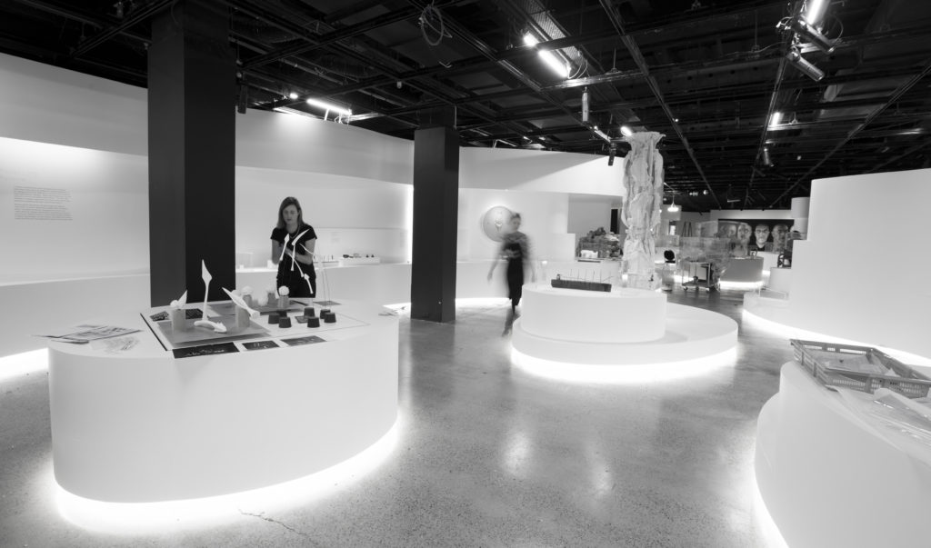 Out of Hand: materialising the digital, exhibition installation. Staff at work.