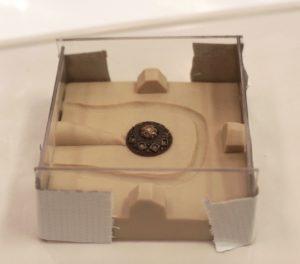 Original button embedded in plasticine
