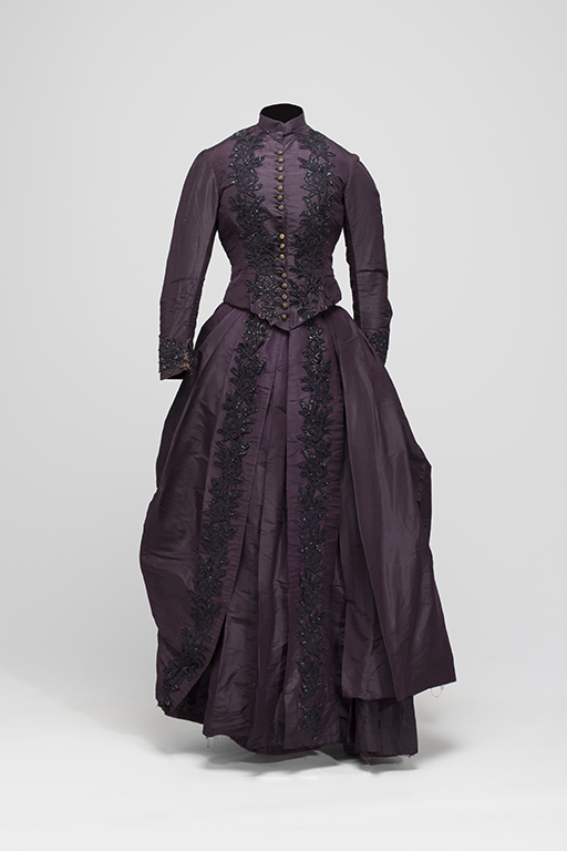 Full length photo of Janet McDonald's purple wedding gown