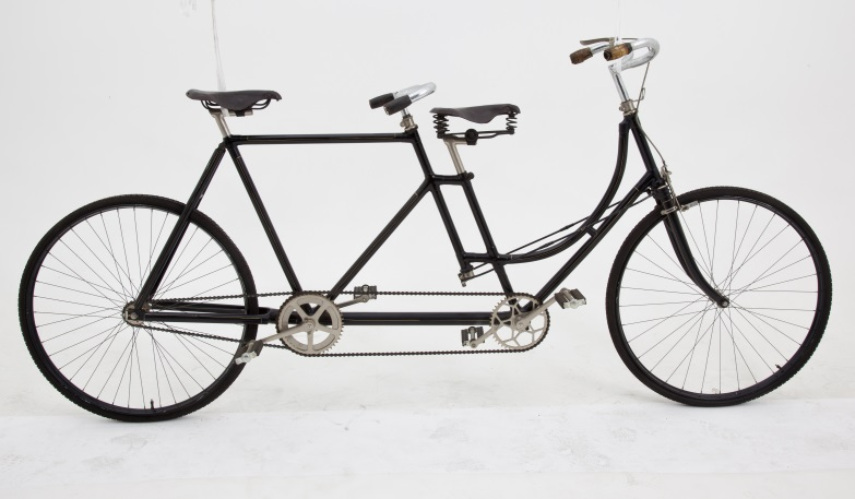 Tandem safety bicycle, loop frame lady front and gents rear type