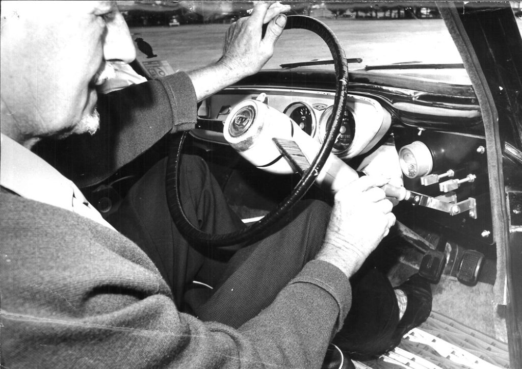 Roy Doring in the late 1960s demonstrating operation of his 1959 electric car's Trumbull