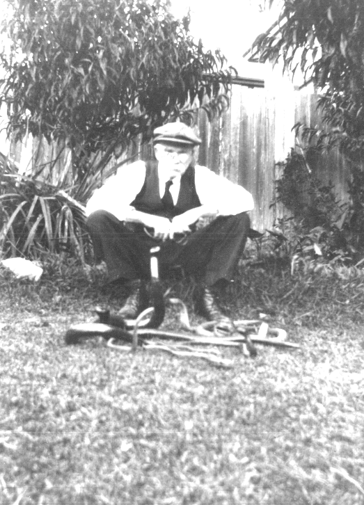 Photograph of Robert Read with examples of his carvings
