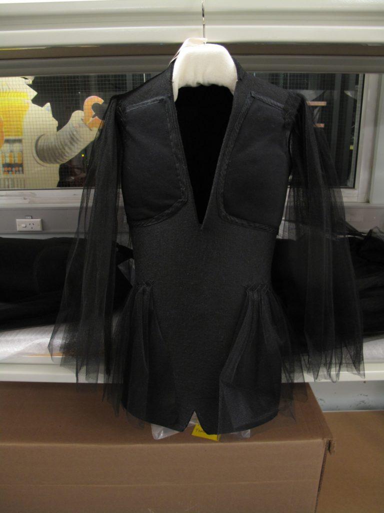 Photograph of black jacket on 'invisible' felt mount