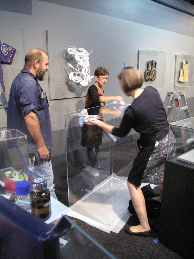 Staff preparing acrylic covers