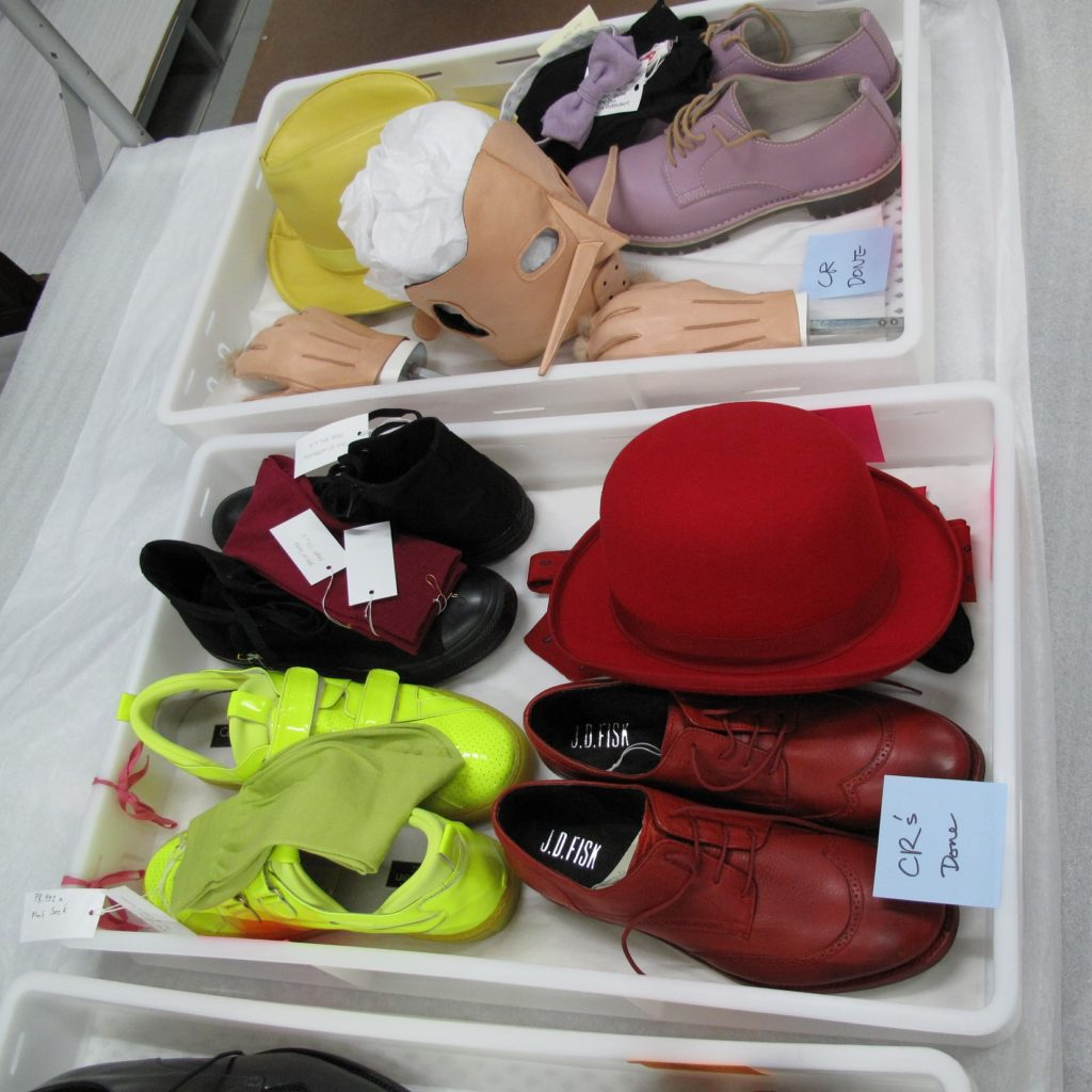 Photograph of trays holding accessories for the contemporary ensembles