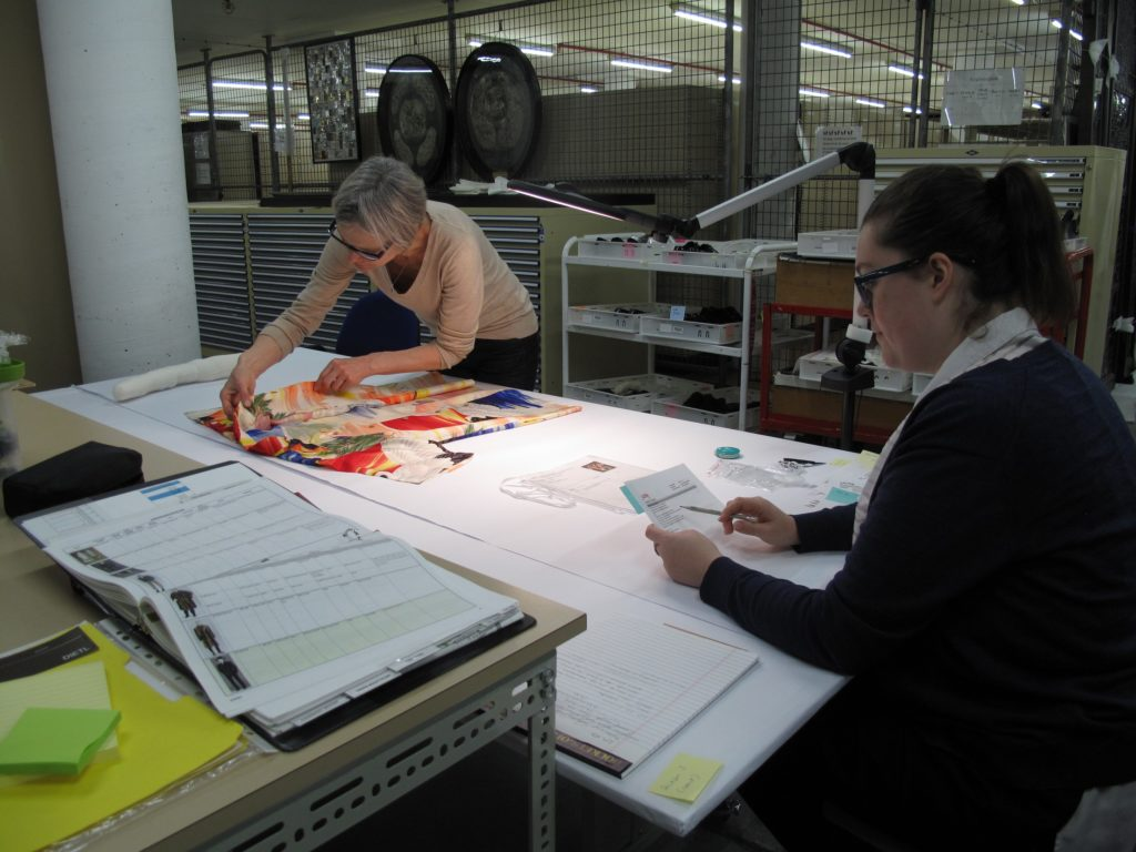 LACMA conservator and MAAS Assistant Conservator examine objects to record condition changes