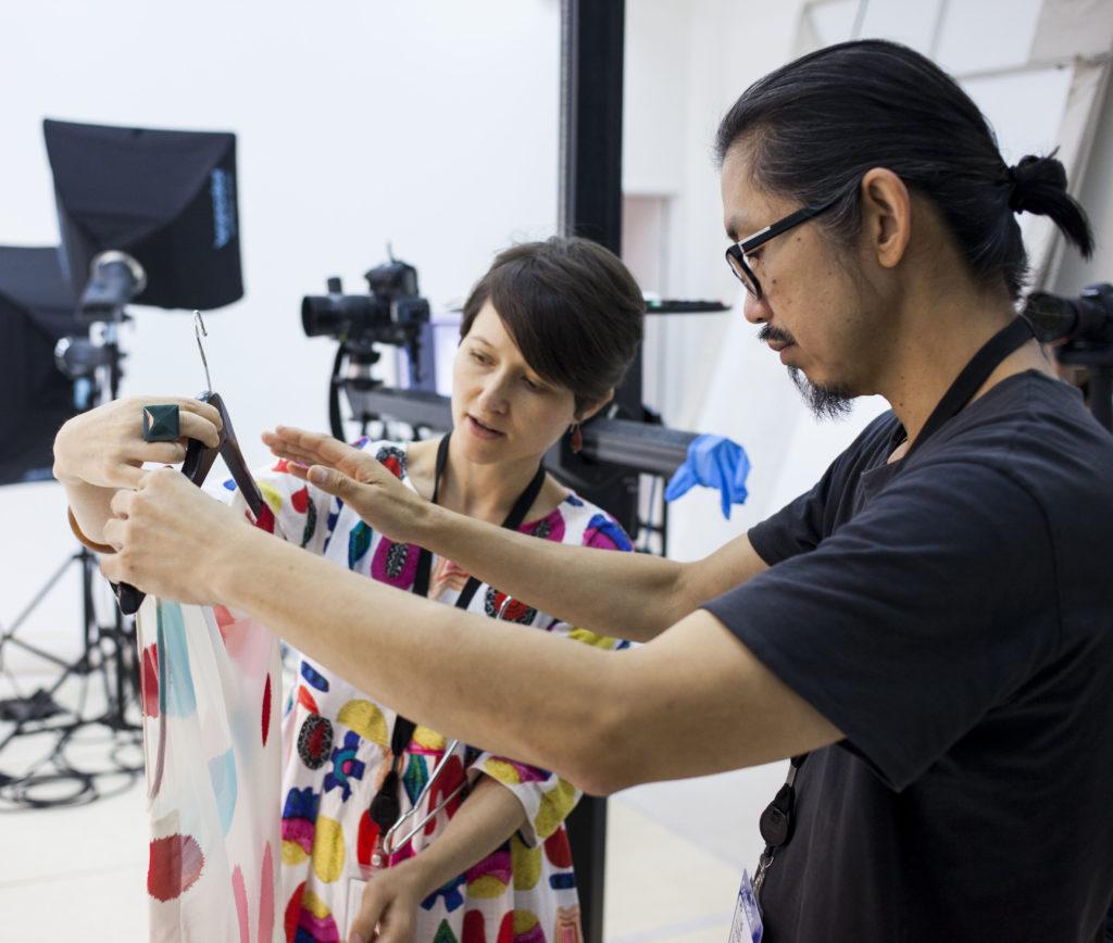 Akira Isogawa with MAAS Curator Kristina Stankovski, preparing an asymmetrical spot-print top