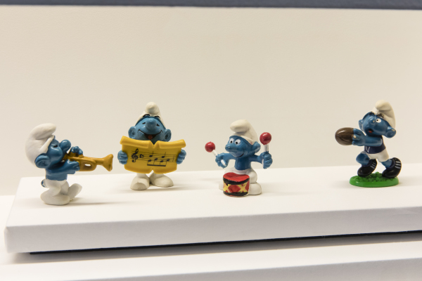 Photograph of Four Smurf figurines on display