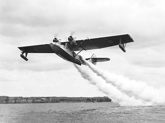 Catalina taking off with JATOS (Jet Assisted Take Off rockets).
