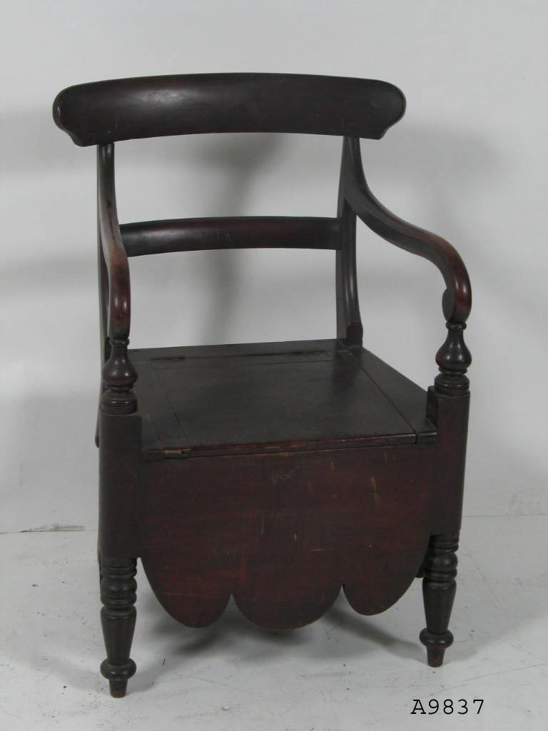 Red Cedar and mahogany commode chair with a hinged lid seat