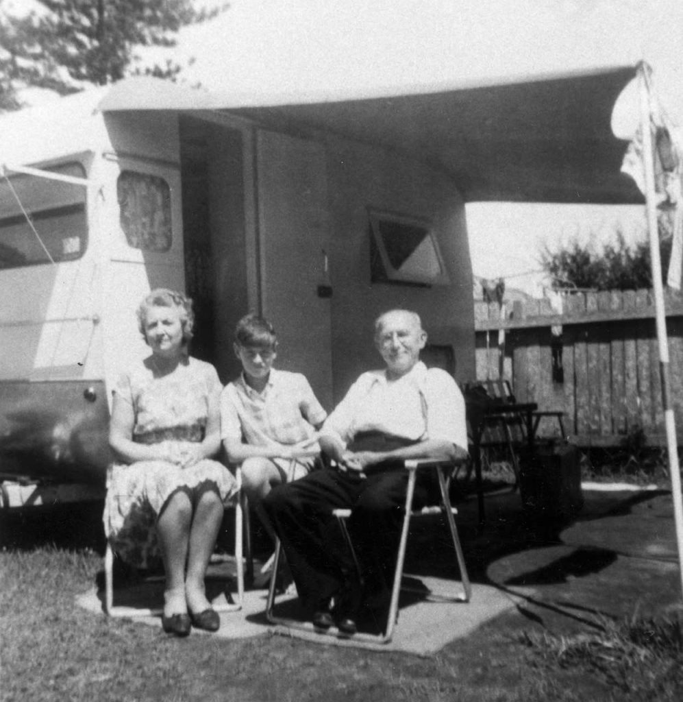 The Rhead family outside their 1960s caravan.