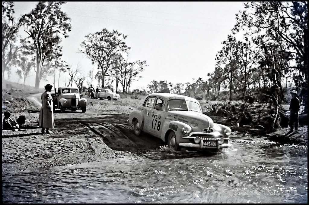 An FJ Holden negotiating a creek