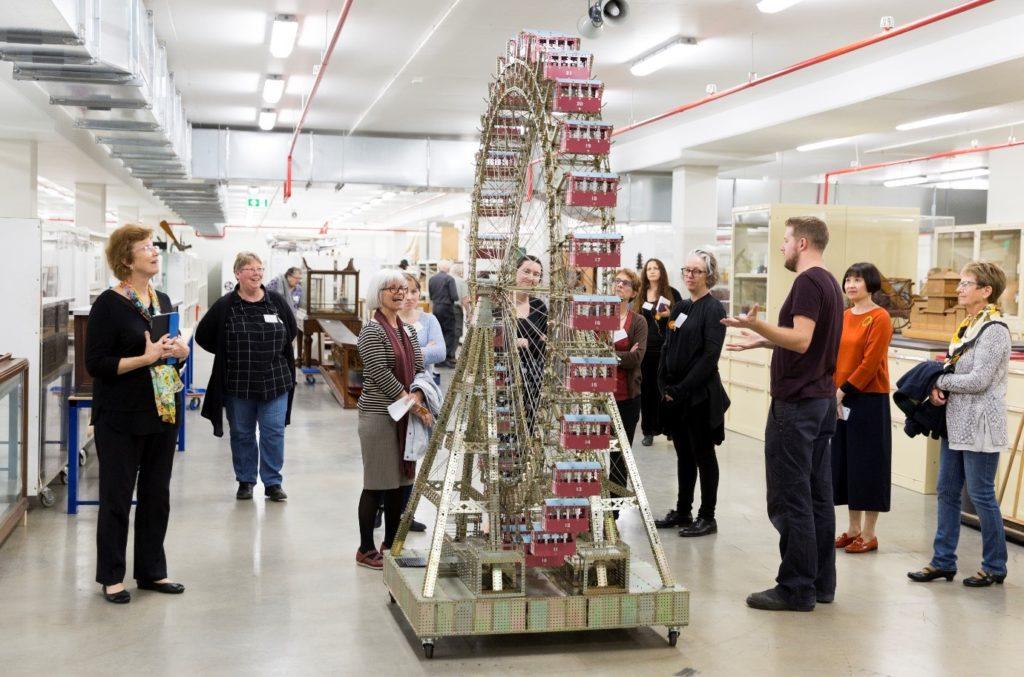 Scott Winston giving a tour surrounding a 3m high Mecanno Ferris Wheel.