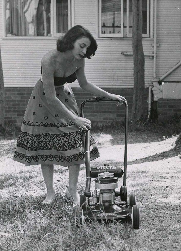 Female model marketing Victa Lawnmower