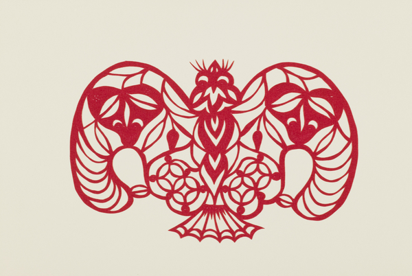 An image of a red papercut. 'Golden Coin, Good Fortune and Longevity' (jīn qián fú shòu).
