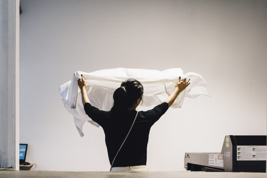 Woman laying out white fabric