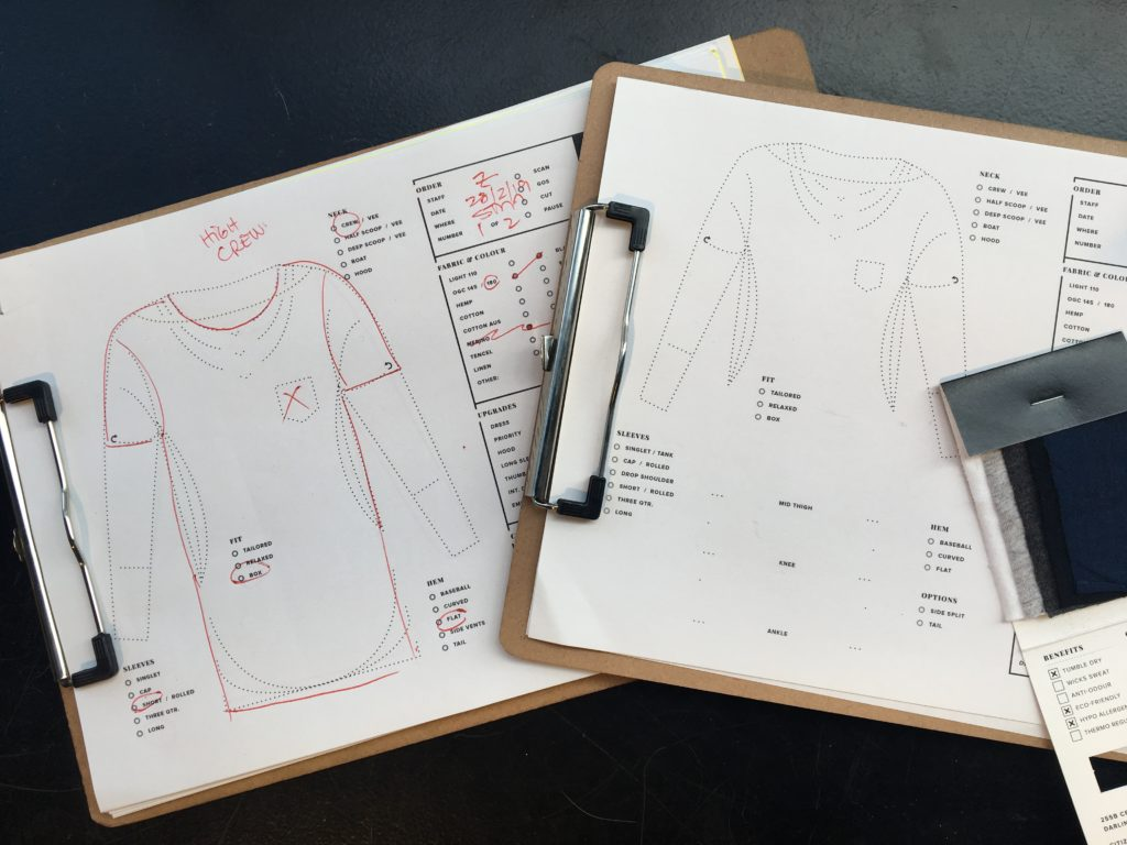 Clipboards showing customer specifications and design options