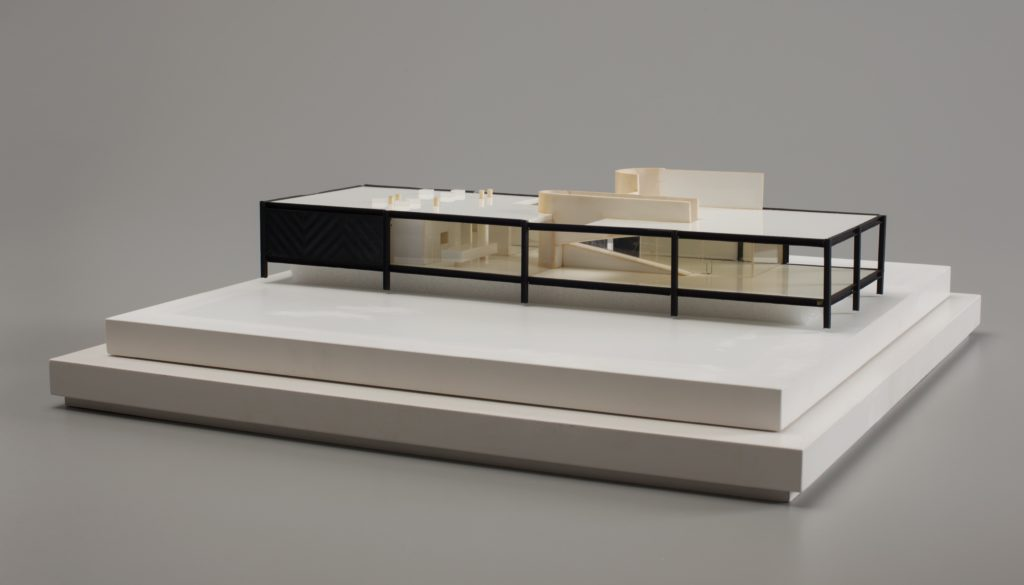 Architectural model of modernist house with flat roof