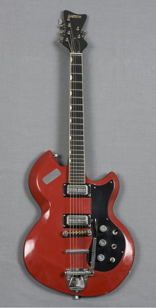 Electric guitar with case and accessories, 'Astro-Jet', made by Gretsch in the USA, used by Deborah Conway in Australia during the 1990's. MAAS collection: 93/236/1. Image: Nitsa Yioupros