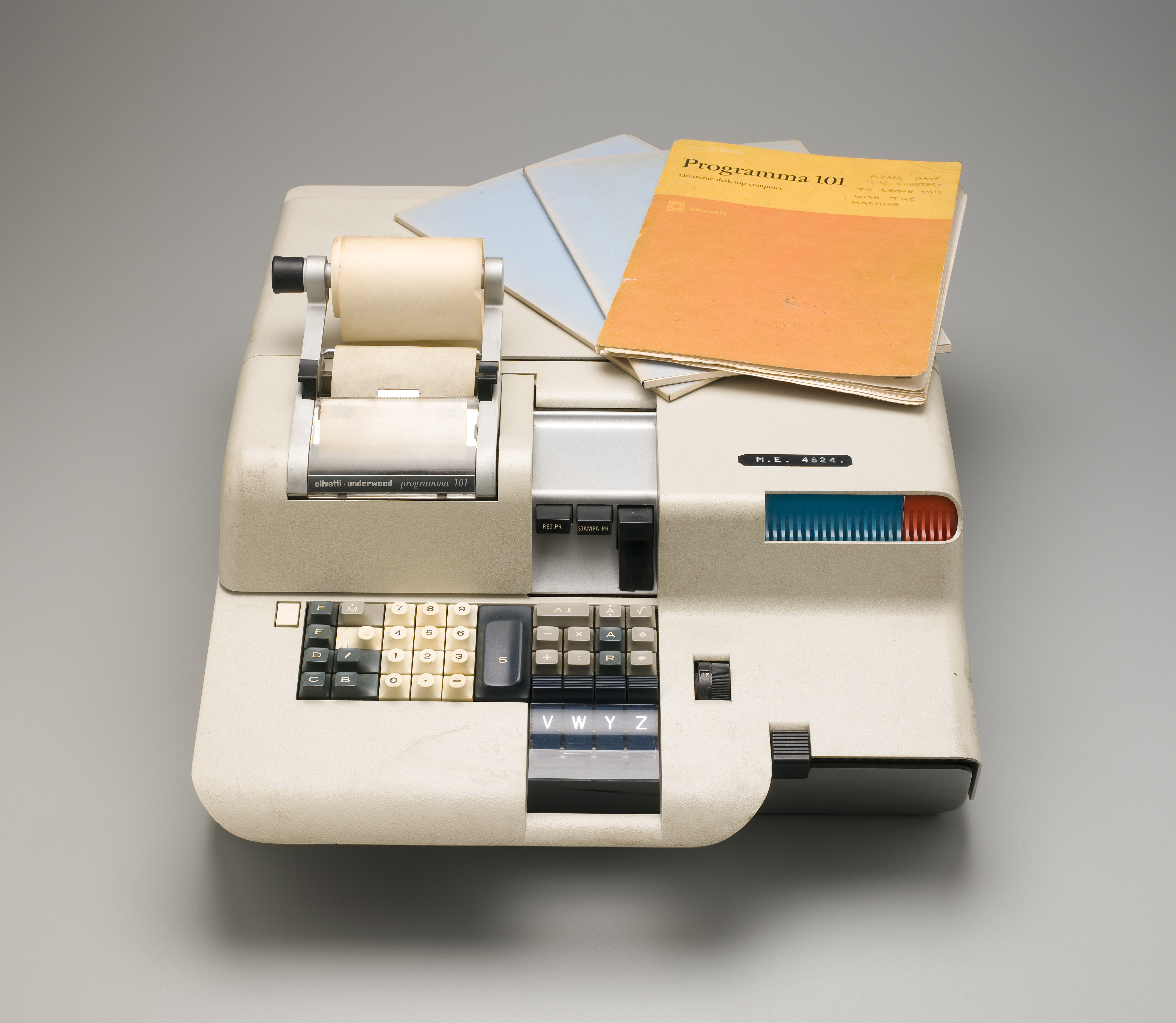 An early computer, measuring about 40cm, with a number pad and paper roll for printing out calculations.
