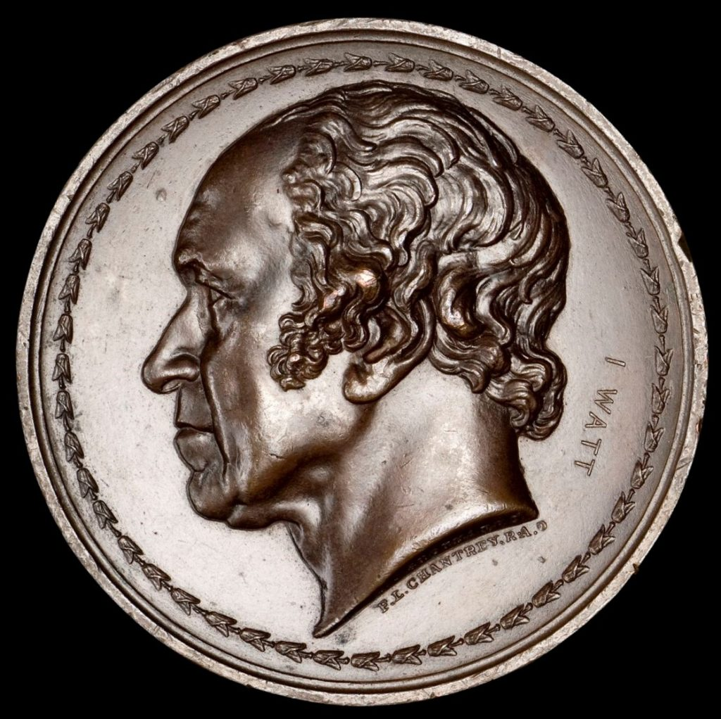 Bronze medal with left-facing profile in deep relief of a man with wavy hair, sideburns, a high forehead and Roman nose. The disk is encircled by a laurel wreath and engraved on the right with the name I Watt.