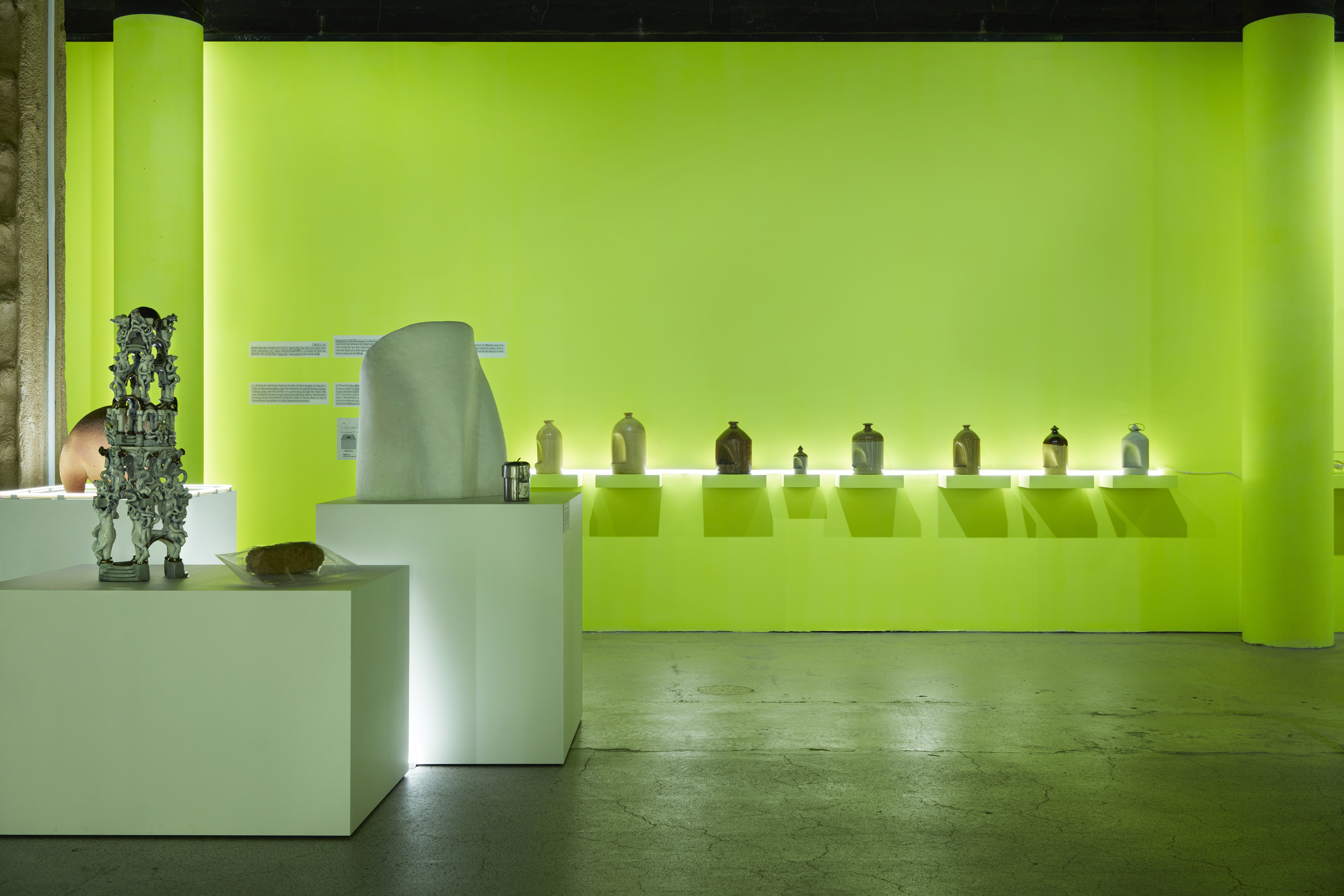 Installation view of the I Prefer Talking to Doctors About Something Else exhibition showing 'Milos 1' by ceramicist Marea Gazzard next to an emergency breathing apparatus and a series of ceramic bird feeders in the background.