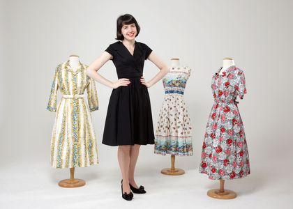 Rebecca Evans with vintage dresses from the Museum's collection