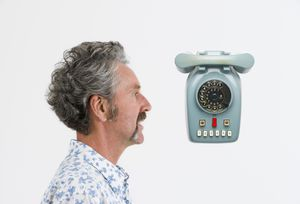 Campbell Bickerstaff, Curator, with telephone designed by Marcello Nizzoli, Italy, 1958, MAAS collection