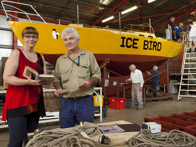Volunteers and staff working on the conservation of the 'Icebird' yacht at the Discovery Center