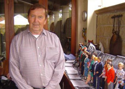 John Willmott Potts standing with his collection of Barbie and Ken dolls. Image courtesy of John Willmott Potts